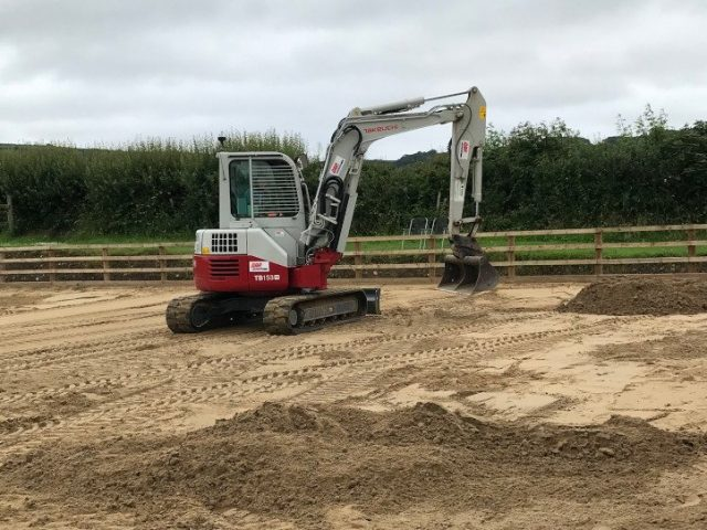 Burry Port Arena Surface Installation - sand being laid for sand & fibre arena surface