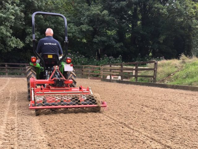 Beta-Ride Arena Maintenance - Equestrian sand & fibre arena surface being levelled