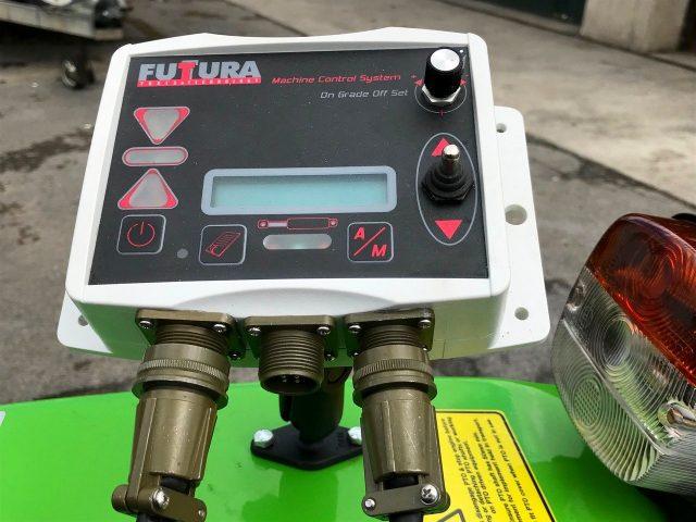 Laser grader for equestrian arena maintenance
