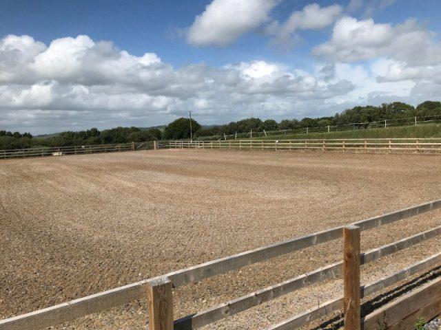 Burry Port Arena Surface Installation - sand & carpet fibre arena surface