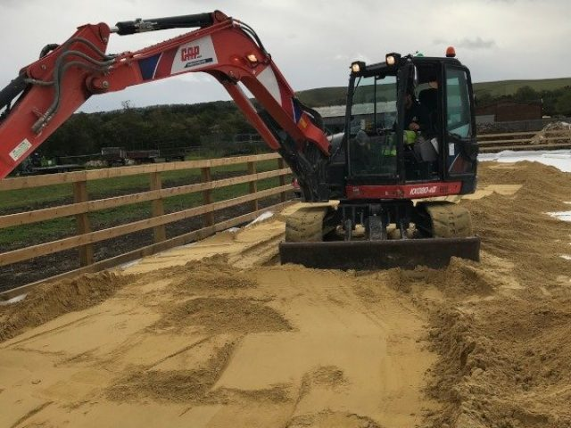 Beta-Ride Woolstone Equestrian Arena Build - Sand being laid