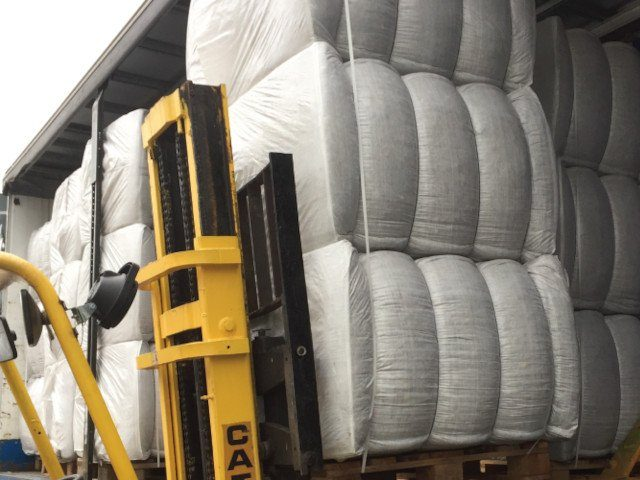 Beta-Ride bale delivery being loaded by forklift
