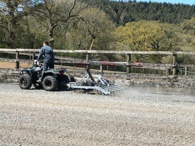 Harrowing a sand & carpet fibre arena surface